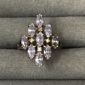 10k ring with light purple stones and diamonds